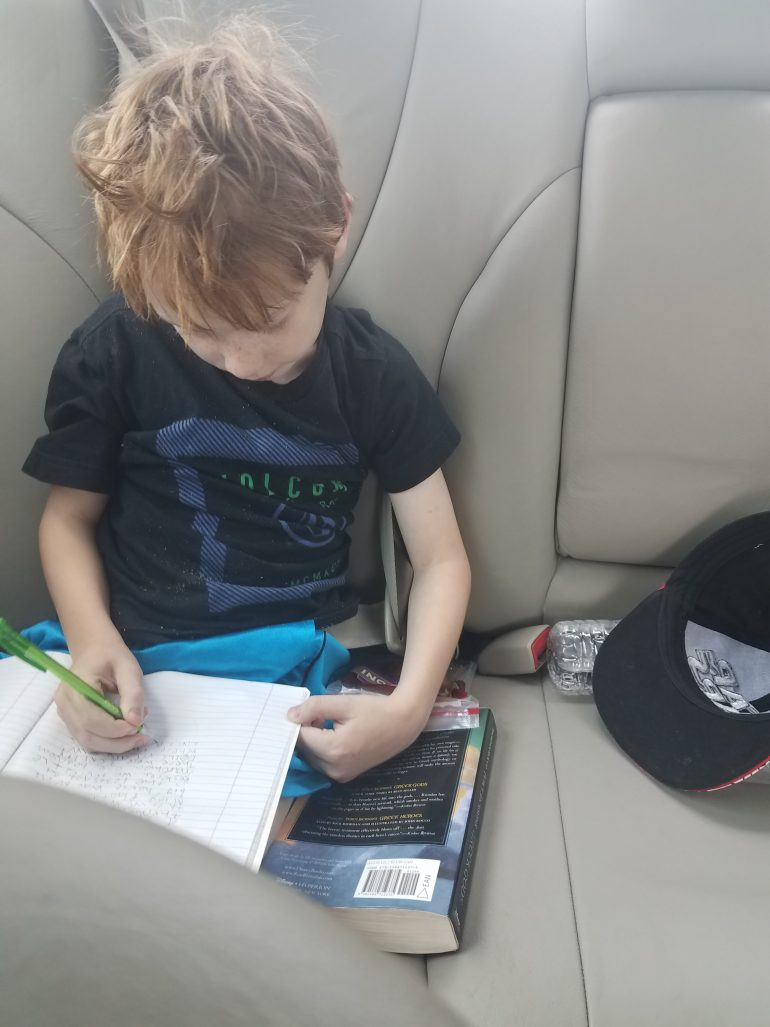 henry-writing-in-car-minniemonsters.com